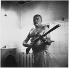 Ernest_Hemingway_at_the_Finca_Vigia,_Cuba_-_NARA_-_192663